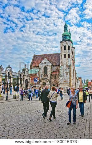 Krakow Poland - May 1 2014: People at St Andrew Church in the old town of Krakow Poland.
