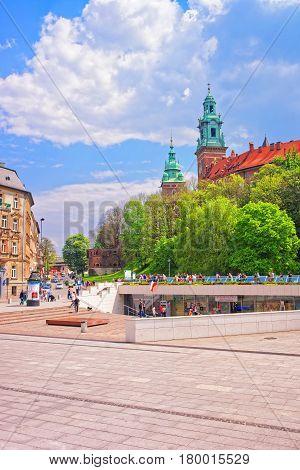 People In Krakow City Center With Wawel Castle