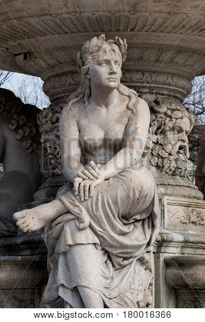 Budapest, Hungary - March 08, 2017: Fragment of neo-renaissance Danubius Water Fountain placed in Erzsebet square since 1959. Women statue symbolise one of the main rivers of the country