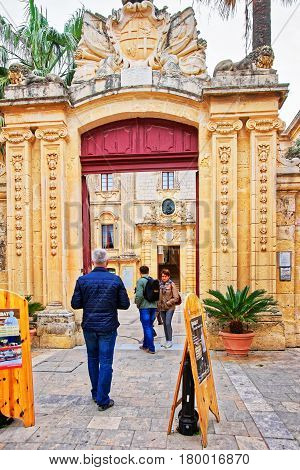 People At Entrance Gate Into Natural History Museum Mdina Malta