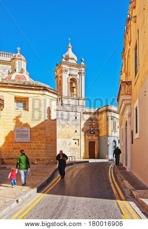 People At St Paul Cathedral In Mdina On Malta