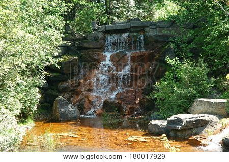 water fall rocks pond stream trees green