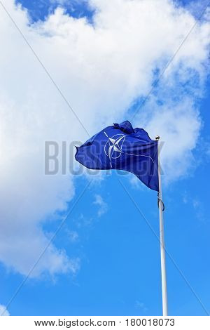 Flag Of Nato Waving By Wind