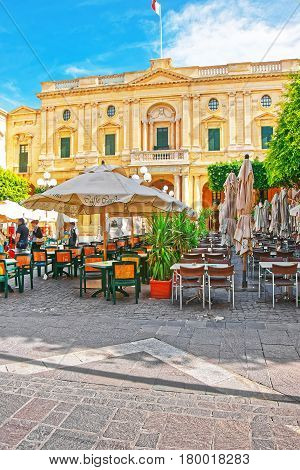 People Resting At Open Air Cafes On Republic Square Valletta