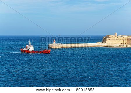 Dry Cargo Carrier And Breakwater At Fort Ricasoli Of Kalkara