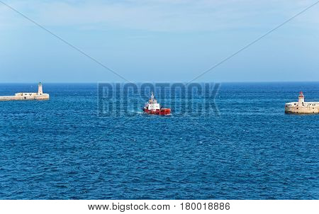 Dry Cargo Vessel At Breakwaters Of Ricasoli And St Elmo