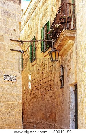 Narrow Silent Street With Lamp And Balcony In Mdina