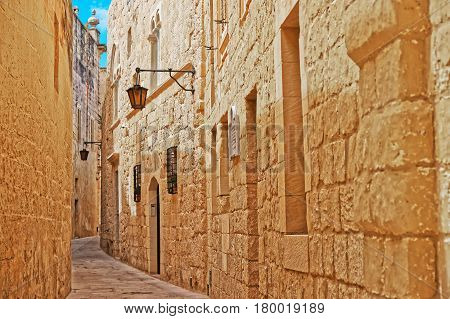 Narrow Silent Street With Lantern In Mdina