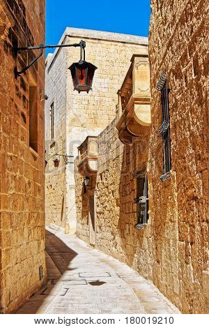Narrow Street With Lamp And Balcony At Mdina Old Town