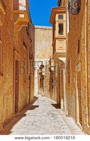 Narrow Street With Lamp And Balcony In Mdina Old Town