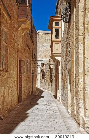 Narrow Street With Lantern And Balcony At Mdina Old Town