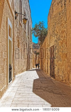 People At Narrow Silent Street With Lantern Mdina