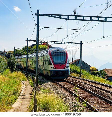Running Train At Vineyard Terrace Of Lavaux Switzerland