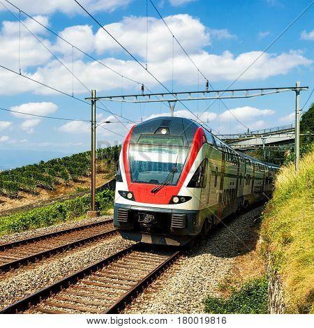 Running Train In Vineyard Terrace Of Lavaux Of Switzerland