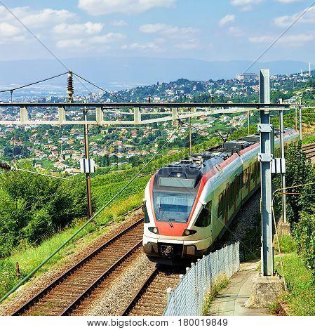 Running Train In Vineyard Terraces Of Lavaux In Switzerland