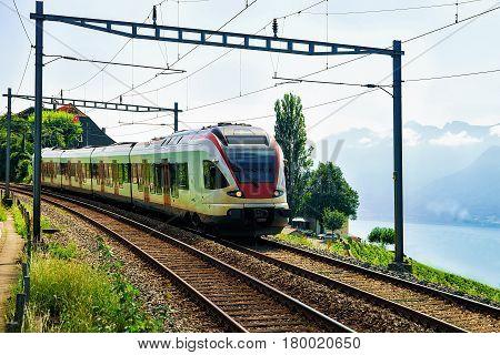 Train At Vineyard Terraces Of Lavaux Near Lake Geneva Alps