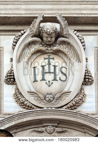 ROME, ITALY - SEPTEMBER 01: Christogram IHS, facade of the Church of the Gesu, mother church of the Society of Jesus, Rome, Italy on September 01, 2016.