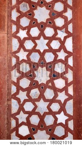 FATEHPUR SIKRI, INDIA - FEBRUARY 15 : Beautiful stone carvings on the wall in Fatehpur Sikri complex, Uttar Pradesh, India on February, 15, 2016.