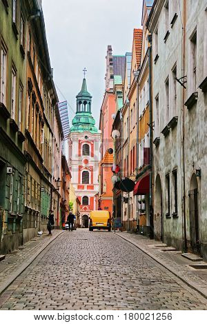 Cobblestone Street And St Stanislaus Church In Old Town Poznan