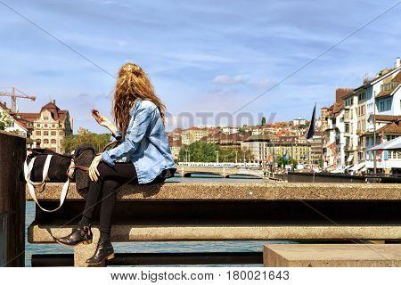Girl Relaxing At Limmatquai Zurich Swiss