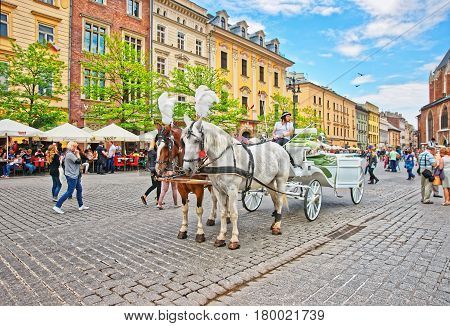Horse Fiacre And People In Old Town Center Of Krakow