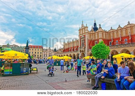 People At Adam Mickiewicz And Cloth Hall Main Square