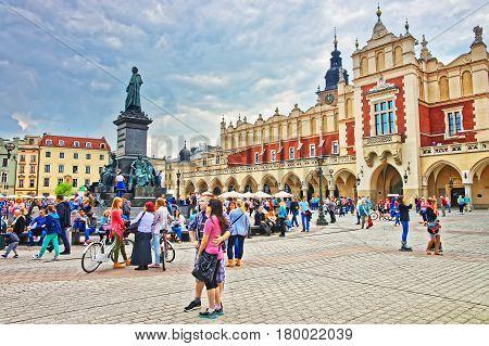 People At Adam Mickiewicz And Cloth Hall At Main Square