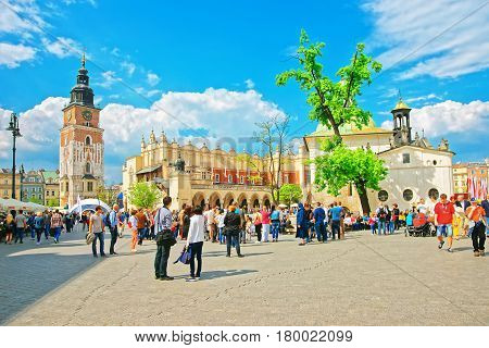 People At Cloth Hall And Town Hall Tower In Krakow