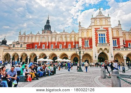 People At Cloth Hall On Main Market Square In Krakow