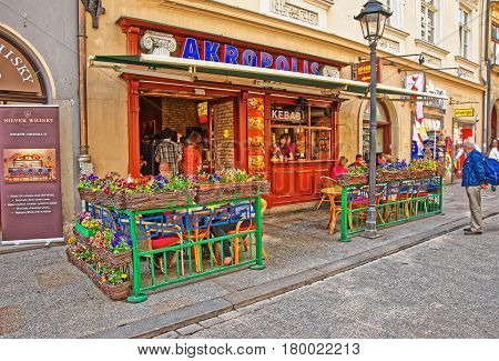 People At Street Restaurant In Krakow