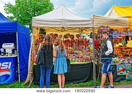 Teenagers At The Stall With Sweet Candies In Krakow