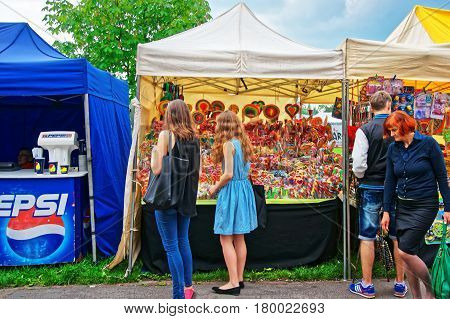 Teenagers At The Stall With Sweet Candies Of Krakow