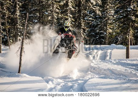 Rider on the snowmobile in the mountains ski resort in Amut Russia.