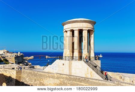 People At Siege Bell Memorial At Christopher Bastion Valletta