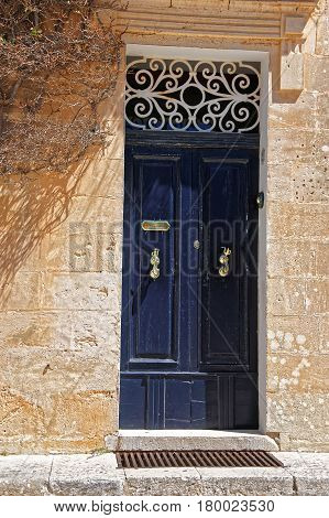 Door with decorative handles Mdina in Malta