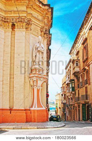 Figure Of Saint At Corner Of Street Valletta Old City