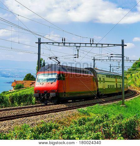 Train And Railroad Near Lavaux Vineyard Terraces Lake Geneva Alps