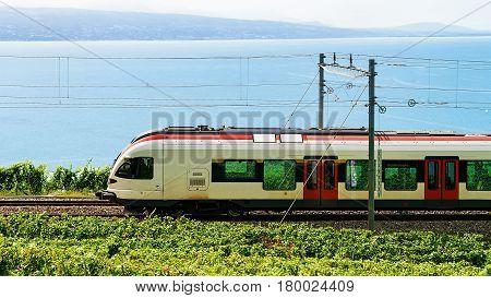 Train At Railroad In Lavaux Vineyard Terrace Lake Geneva Alps