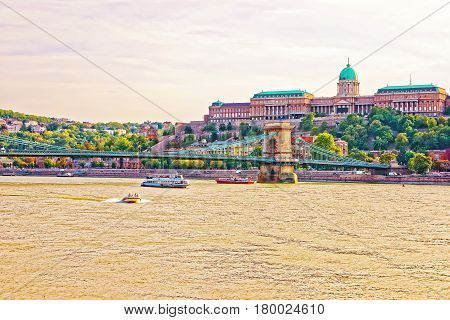 Buda Castle And Water Transport With Chain Bridge In Budapest