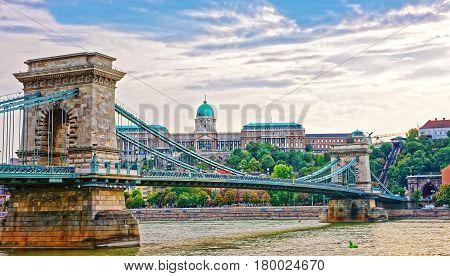Chain Bridge Over Danube River And Buda Castle In Budapest