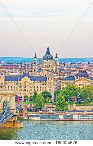Chain Bridge Over Danube River And Saint Stephen Basilica Budapest