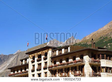 Chalet With Flowers On Balconies At Zermatt Resort Village Swiss