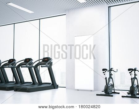 Treadmills, bicycle simulators and blank roll-up bunner in bright interior. 3d rendering