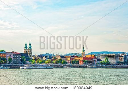 Ferry And Buda City With University Church Spire At Danube