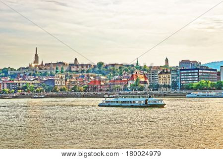 Ferry In Danube River And Buda City Embankment In Budapest