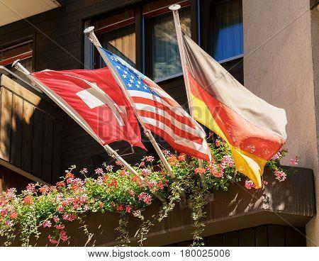 Flags And Chalets In Resort Village Zermatt
