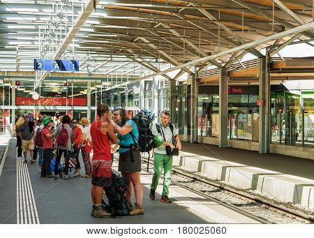 Girl Giving Welcome To Young Man At Railway Station Zermatt