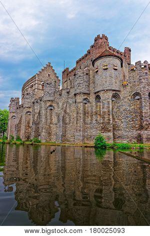 Gravensteen Towers And Leie River In Ghent In East Flanders