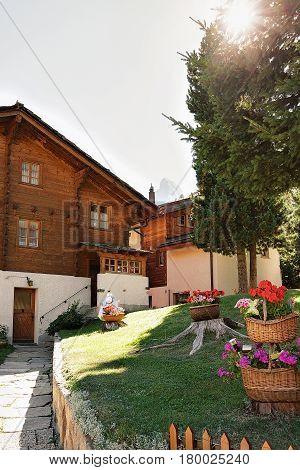 Inner Yard With Traditional Swiss Chalet In Zermatt