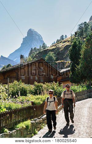 Senior Tourists In Zermatt With View On Matterhorn Summit